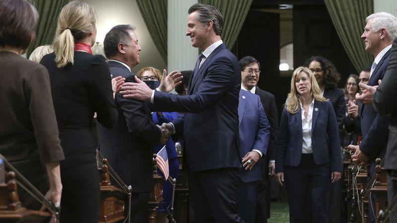 California Gov. Gavin Newsom, center, shakes hands with Assemblyman Phil Ting (D-San Francisco)