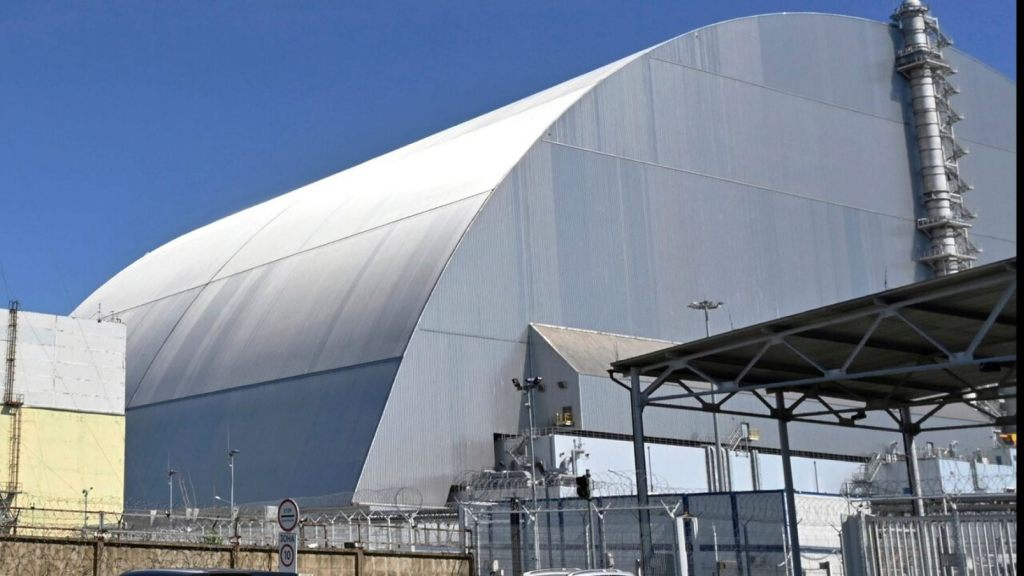 This June 1, 2019, file photo shows a view of the New Safe Confinement (NSC) movable enclosure at the nuclear power plant in Chernobyl, Ukraine. A new structure built to confine the Chernobyl