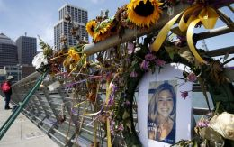 In this July 17, 2015, photo, flowers and a portrait of Kate Steinle remain at a memorial site on Pier 14 in San Francisco.