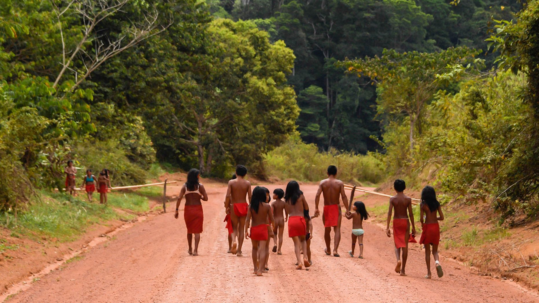 Brazilian Waiapi walk on the road of the Waiapi indigenous reserve,