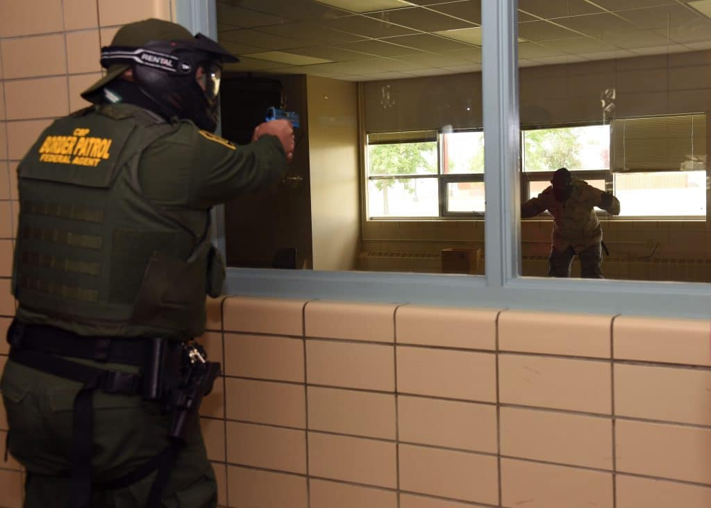A U.S. Customs and Border Protection agent apprehends his target through a classroom window during active-shooter training at Carl Ben Eielson Elementary School Aug. 9, 2017,