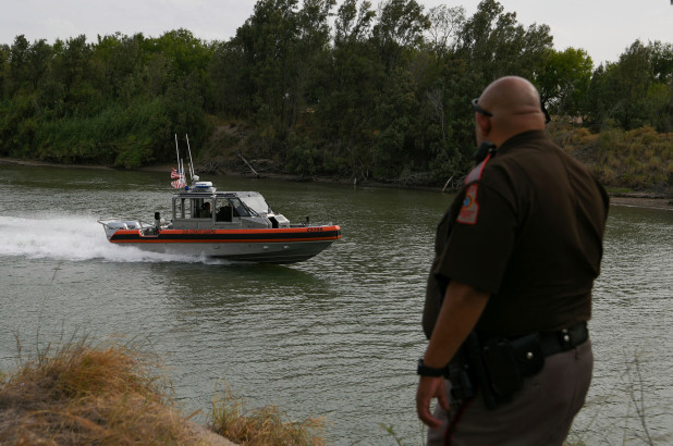 A U.S. Coast Guard boat deployed for U.S.-Mexico border security operations navigates the Rio Grande.