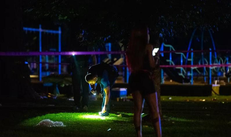 Chicago police investigate the scene where seven people were shot, Aug. 4, 2019,