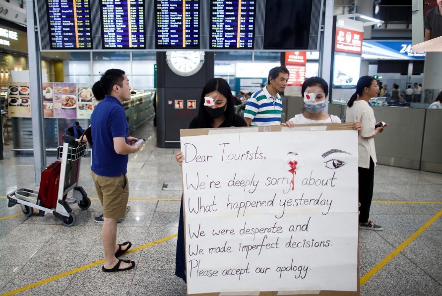 Anti-government demonstrators apologize for yesterday's clashes with police at the airport in Hong Kong China August 14,