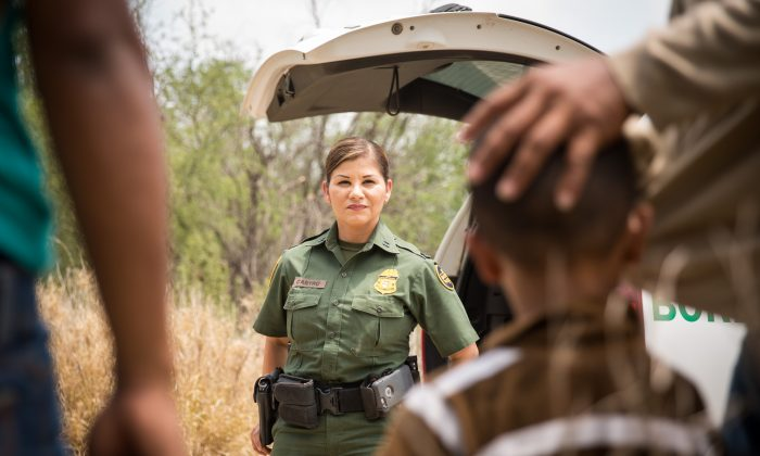 Supervisory Border Patrol agent Marlene Castro speaks to a group of illegal aliens