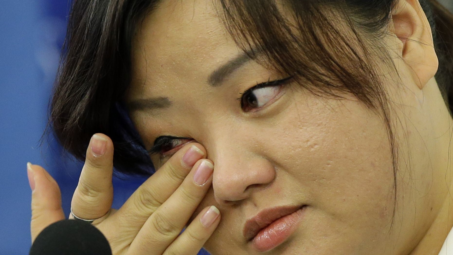 Jin hye Jo wipes a tear as she testifies in Washington D.C. during a hearing of the UN-mandated Commission of Inquiry about human rights in North Korea.