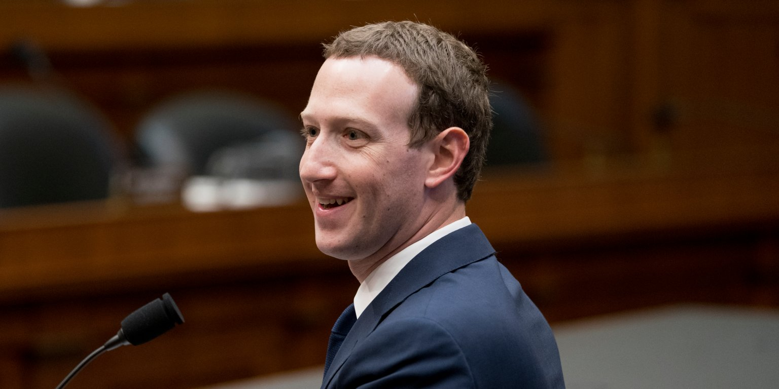 Facebook CEO Mark Zuckerberg smiles while testifying before a House Energy and Commerce hearing on Capitol Hill in Washington, Wednesday, April 11, 2018,