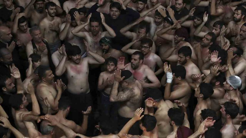 Iranian and Iraqi Shiite Muslims beat their heads during a mourning ceremony marking Ashoura in downtown Tehran, Iran, Tuesday, Sept. 10, 2019