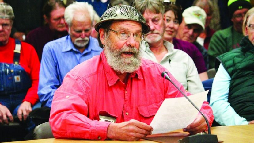 Fritz Creek area resident Barrett Fletcher gives the invocation before a Kenai Peninsula Borough Assembly meeting as a representative of the Church of the Flying Spaghetti Monster at Homer City Hall in Homer, Alaska