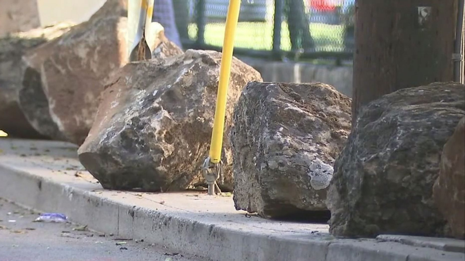 A group of neighbors in San Francisco has had two dozen boulders placed along a residential road to deter people from camping out.