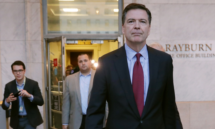 Former Federal Bureau of Investigation Director James Comey leaves the Rayburn House Office Building