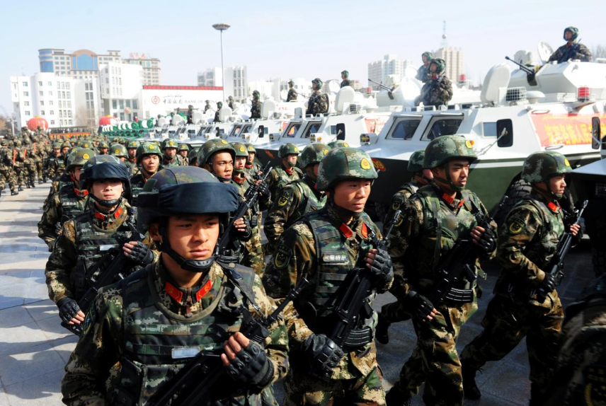 FILE PHOTO: Paramilitary policemen stand in formation as they take part in an anti-terrorism oath-taking rally, in Kashgar, Xinjiang Uighur Autonomous Region, China, February 27, 2017.