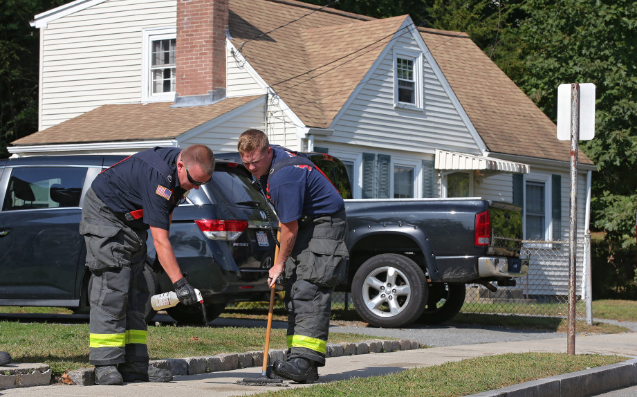 WALTHAM MA. – SEPTEMBER 23: Firefighters clean the sidewalk at the scene of a double stabbing on Wheelock Rd . on September 23, 2019 in Waltham, MA.