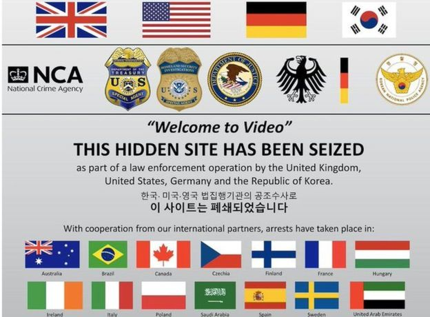 "A ""this site has been seized"" screen with the logos of US, UK, German and other law enforcement agencies."