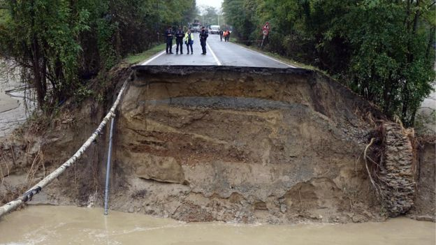 The taxi driver is thought to have died when the road collapsed.