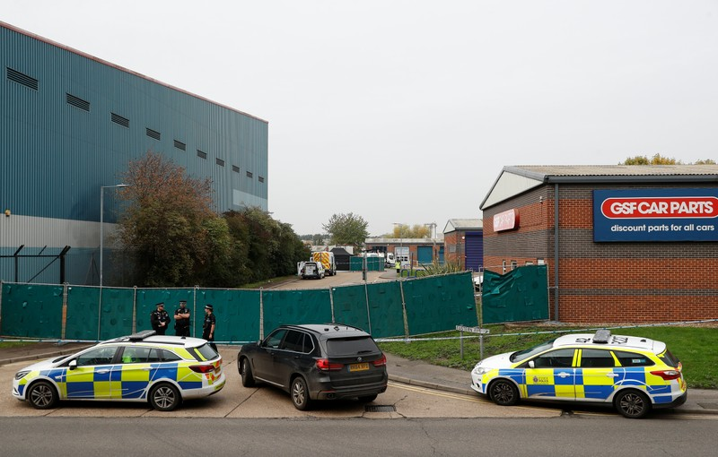 Police is seen at the scene where bodies were discovered in a lorry container, in Grays, Essex, Britain October 23, 2019.