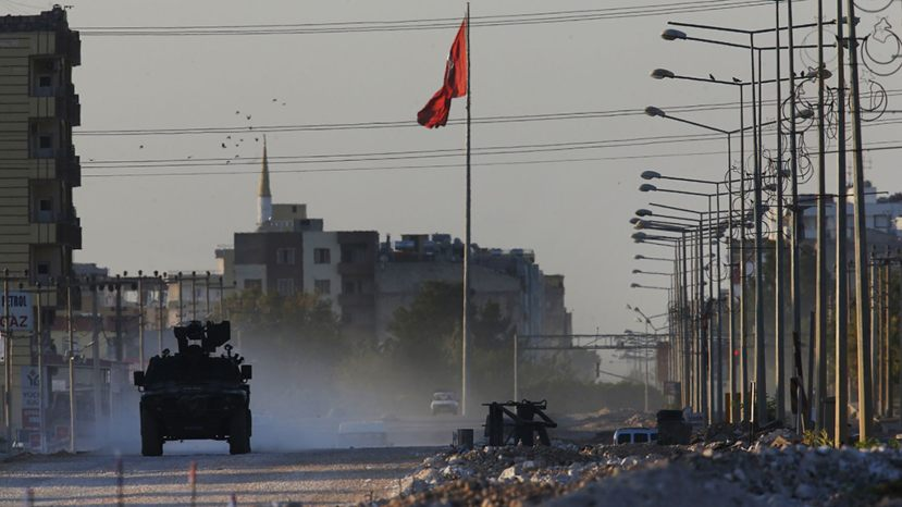 A Turkish police armored vehicle patrols the town of Akcakale, Sanliurfa province, southeastern Turkey, at the border with Syria, Saturday, Oct. 12, 2019. The towns along Turkey's border with northeastern Syria have been on high alert after dozens of mortars fired from Kurdish-held Syria landed, killing several civilians