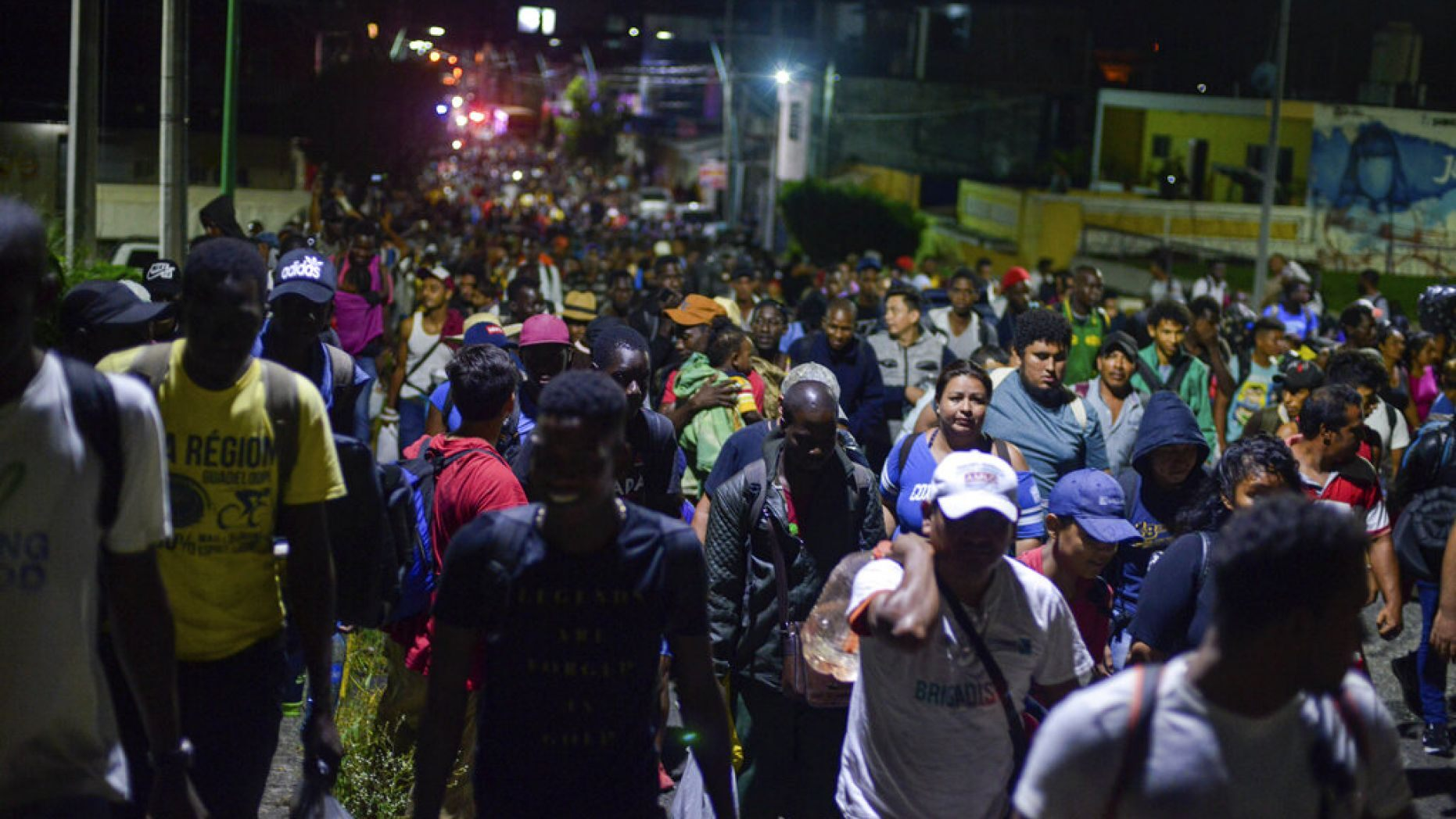 Migrants depart early in the morning from Tapachula, Chiapas state, Mexico, Saturday, Oct. 12, 2019.