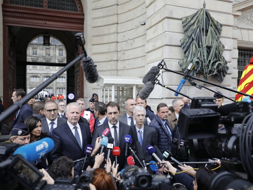 French Interior Minister Christophe Castaner, center, and Paris police leader Didier Lallement, right, give a press conference outside the police headquarters in Paris.