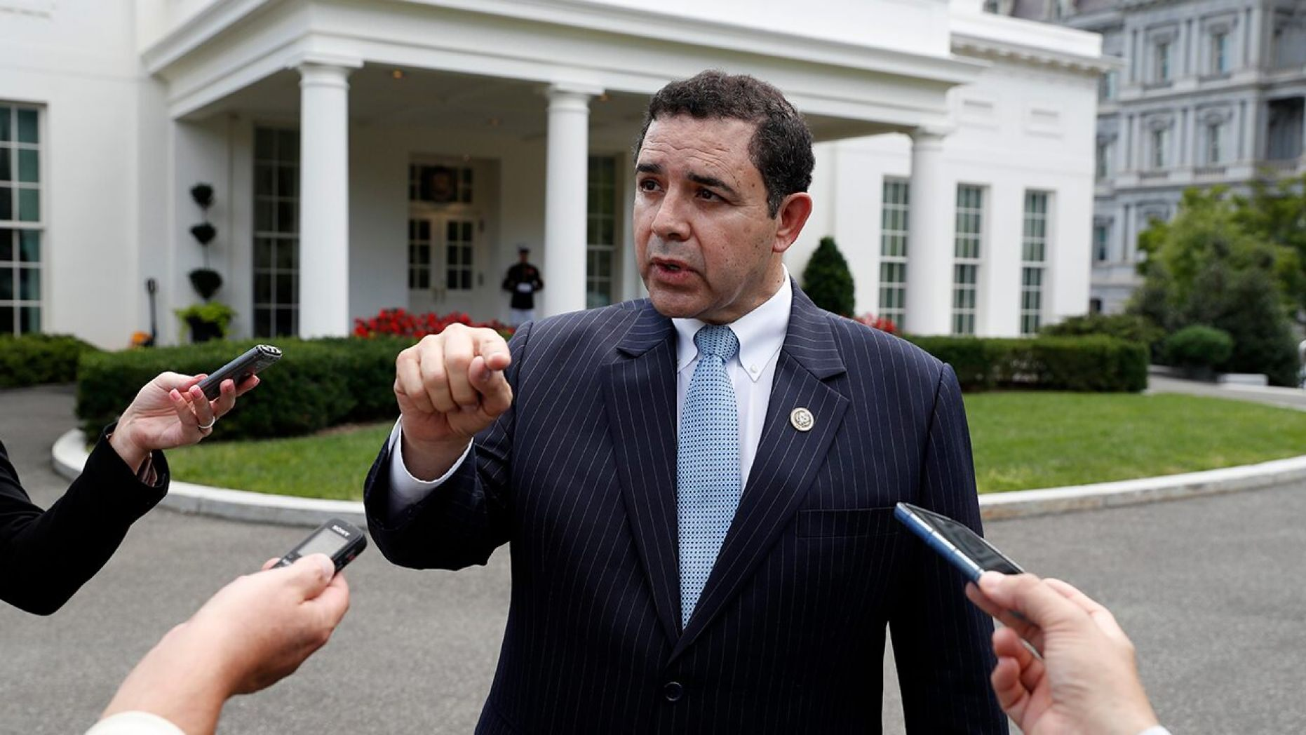 Rep. Henry Cuellar, D-Texas, speaks with the media in front of the West Wing after a bipartisan meeting with President Donald Trump at the White House, Wednesday, Sept. 13, 2017, in Washington.