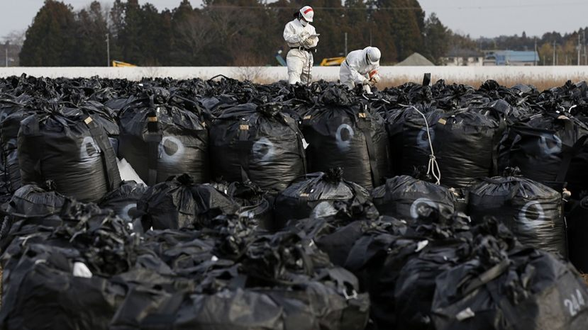 Plastic bags containing greenery collected during decontamination efforts after the 2011 Japanese nuclear disaster were washed down a river during Typhoon Hagibis.
