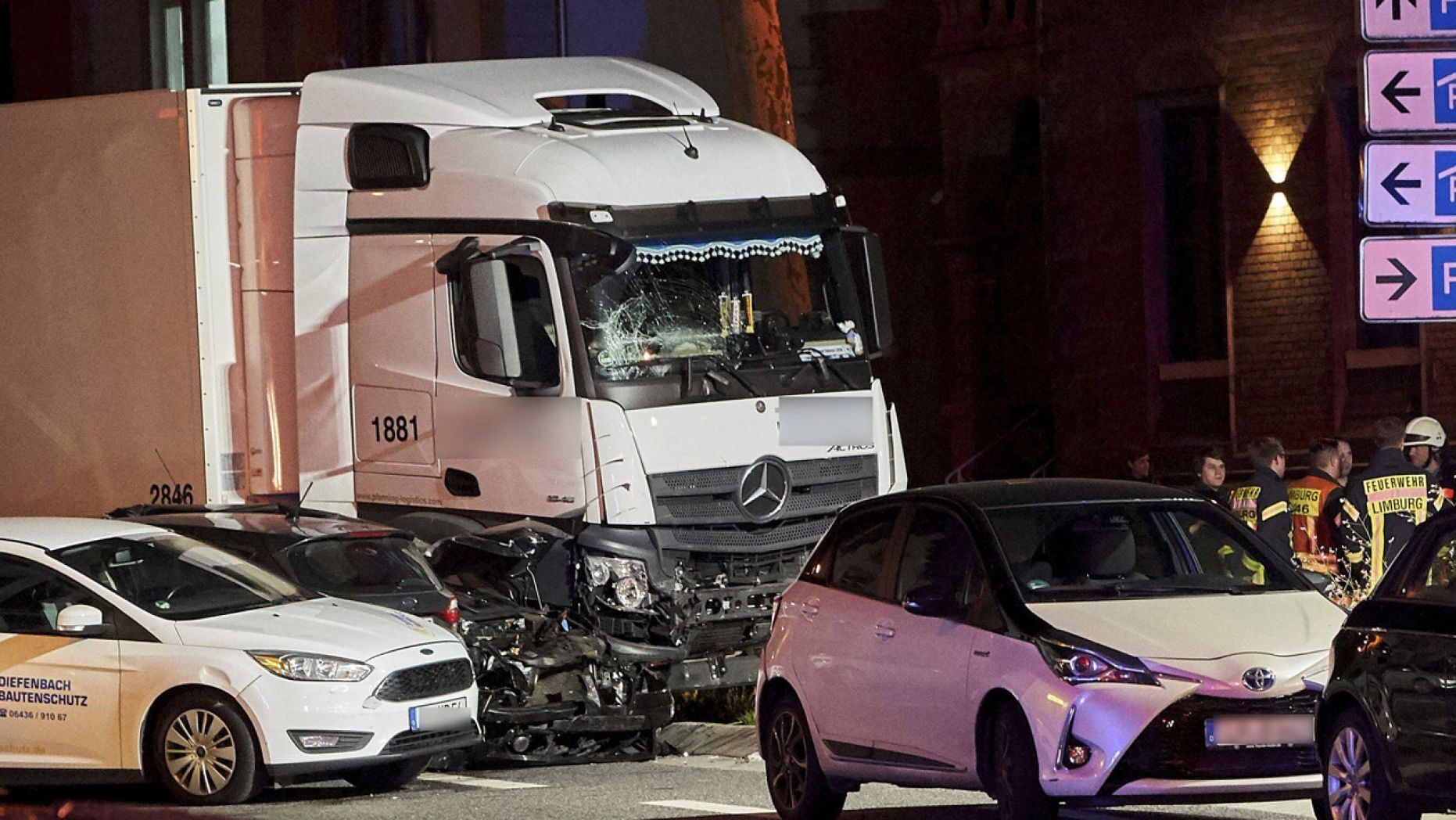 In this Monday, Oct. 7, 2019 photo s truck stands between damaged cars in Limburg, Germany.