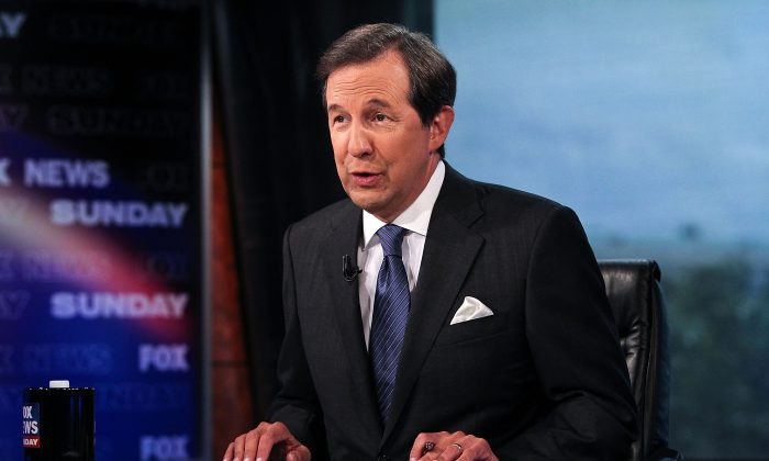 "Chris Wallace takes part in an interview with U.S. Supreme Court Justice Antonin Scalia on ""FOX News Sunday"" at the FOX News D.C. Bureau on July 27, 2012 in Washington, DC."
