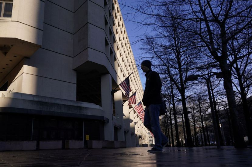 A pedestrian walking past the headquarters of the Federal Bureau of Investigation in Washington.