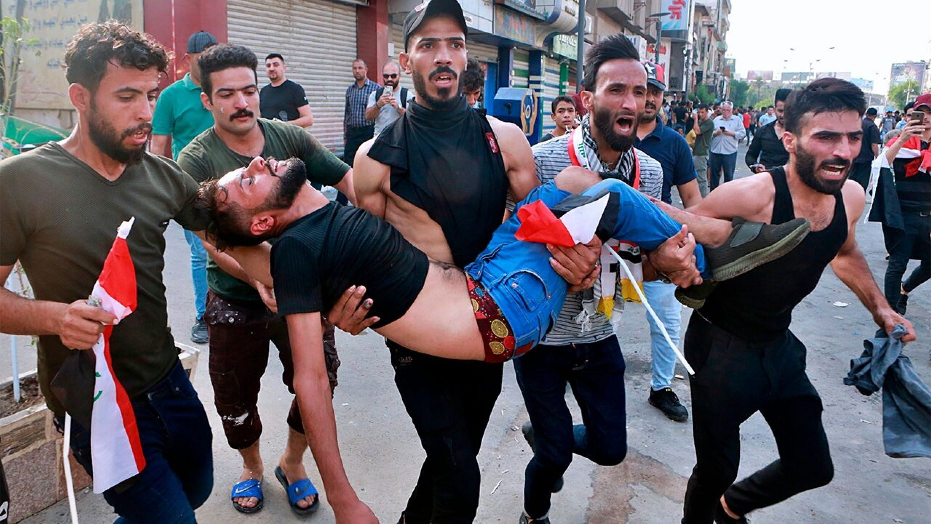 An injured protester is carried off during a protest in Baghdad, Iraq, on Tuesday.