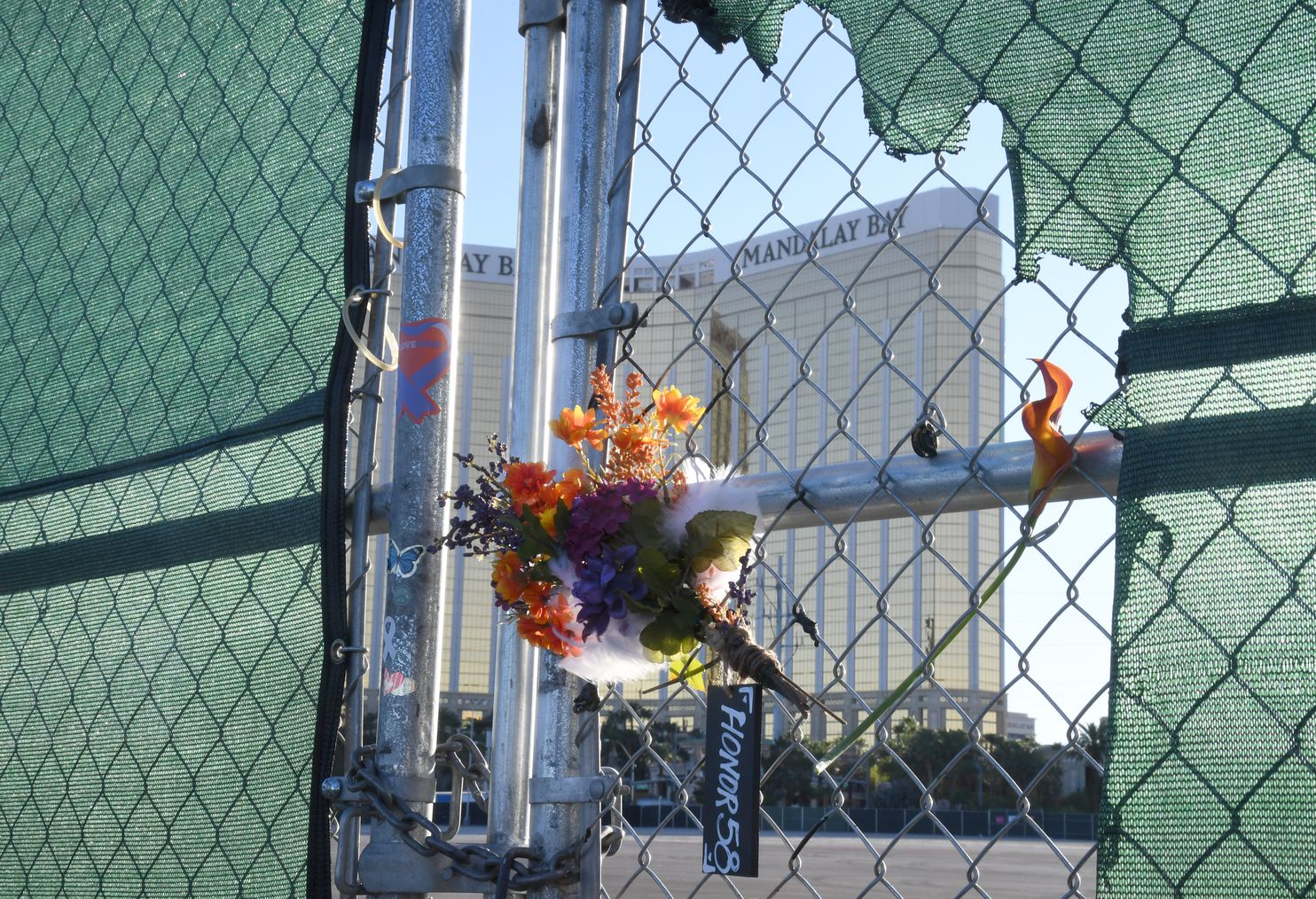 Flowers honoring the Las Vegas shooting victims rest on a fence near the Mandalay Bay Resort and Casino on Monday, a day before the second anniversary of the massacre.