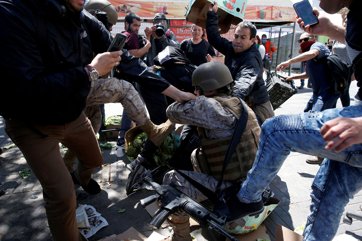 Demonstrators clash with members of the security forces during a protest in Valparaiso on October 21, 2019. #17