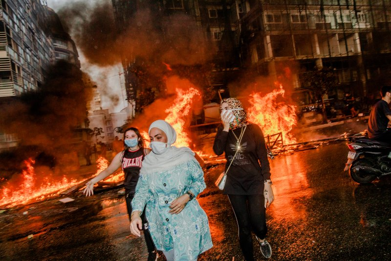 Nour, Nour and Farah attend a mass protest in Beirut on Oct. 18, 2019.