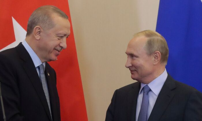 Russian President Vladimir Putin (R) and his Turkish counterpart Recep Tayyip Erdogan shake hands during a joint press conference following their talks in the Black sea resort of Sochi on Oct. 22, 2019.