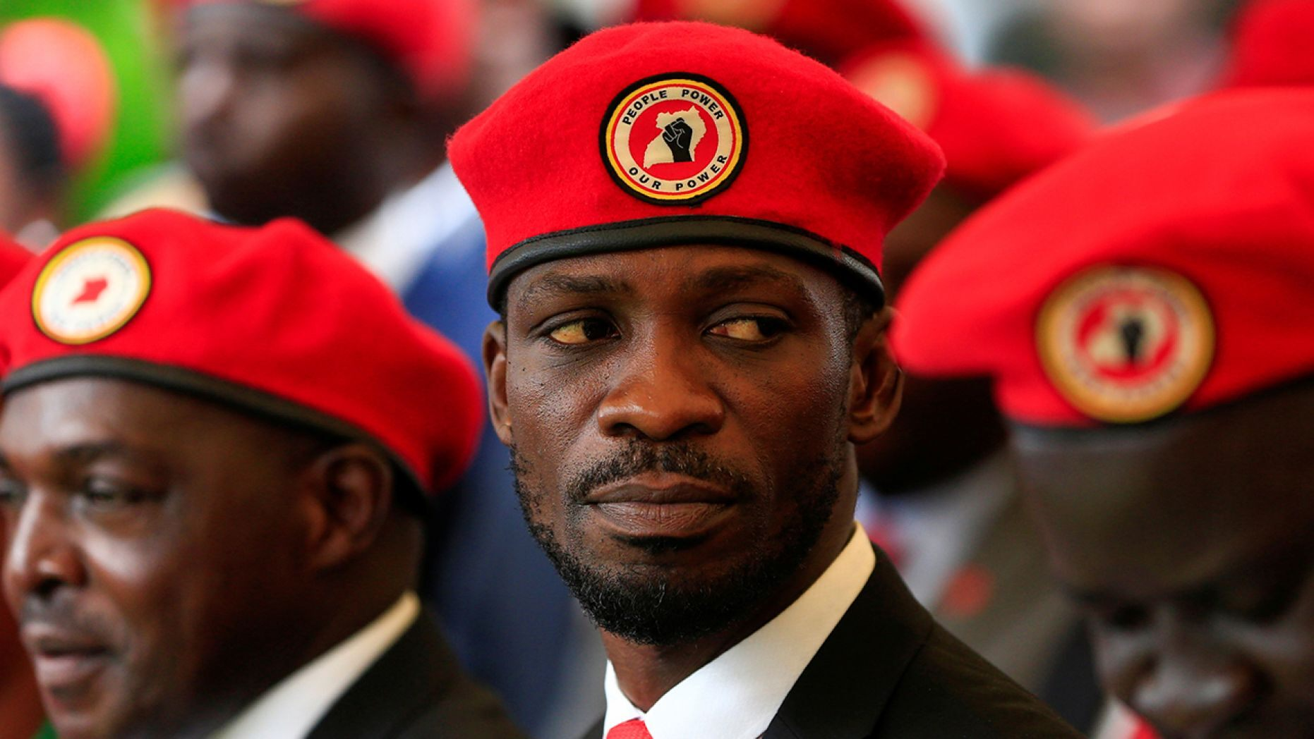 "Wine, a musician turned politician, has called the government's ban on his red berets ""a sham."""