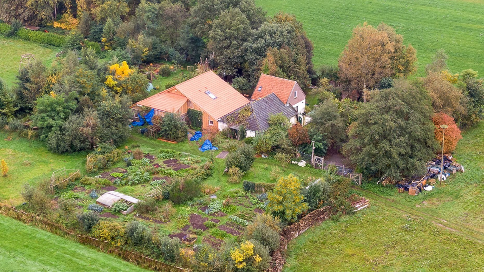 An aerial picture taken on October 15, 2019 shows a view of the farm where a father and six children had been living in the cellar, In Ruinerwold, northern Netherlands.