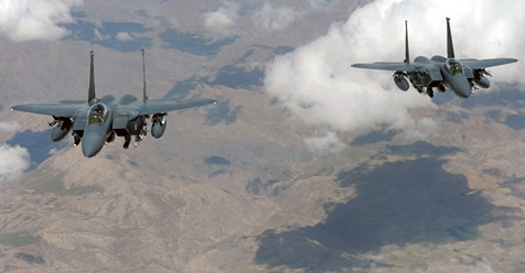 Two U.S. Air Force F-15E Strike Eagle jets fly in formation June 12, 2009, during a combat mission over Afghanistan.