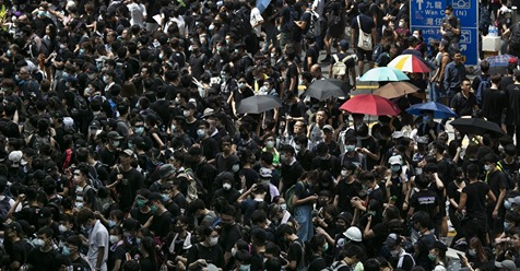 Thousands of protesters surround the police headquarter in Hong Kong on June 21, 2019. The protests continue as the demonstrators are demanding that Chief Executive Carrie Lam step down and call for a complete withdrawal of a controversial extradition bill