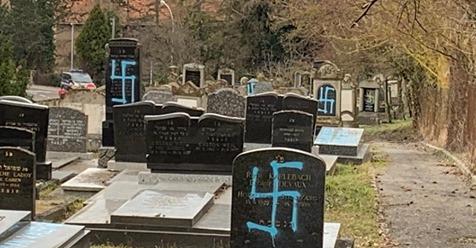 Gravestones at the Jewish cemetery in Quatzenheim, France vandalized with Nazi graffiti, February 19, 2019.