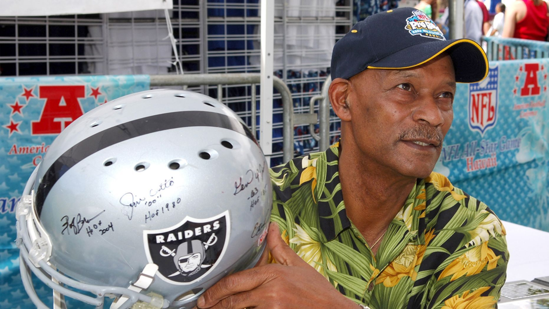 Willie Brown holds an autographed Riddell Raiders helmet at the Pro Bowl Footbal Festival at Kapiolani Park in Honolulu, Hawaii on Saturday, February 11, 2006.