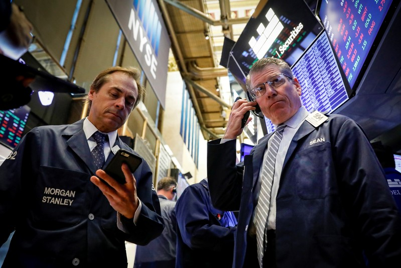 FILE PHOTO: Traders work on the floor at the New York Stock Exchange (NYSE) in New York, U.S., November 6, 2019.