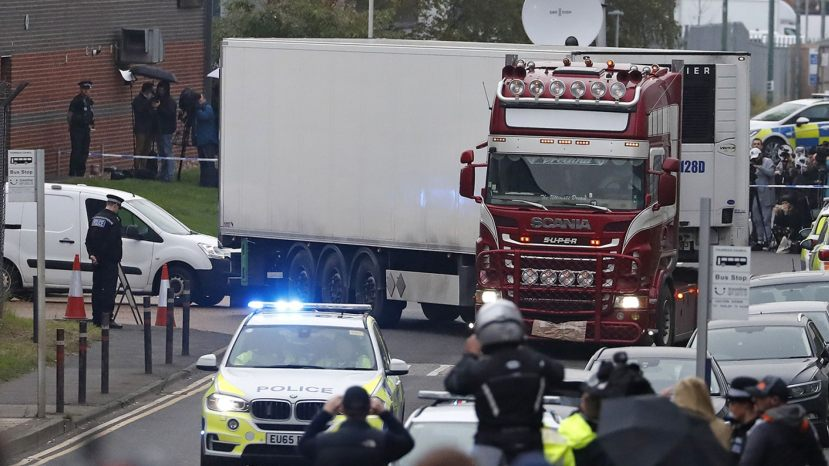 Police escort the truck, that was found to contain a large number of dead bodies, as they move it from an industrial estate in Thurrock, south England, Wednesday Oct. 23, 2019. Police in southeastern England said that 39 people were found dead Wednesday inside a truck container believed to have come from Bulgaria.