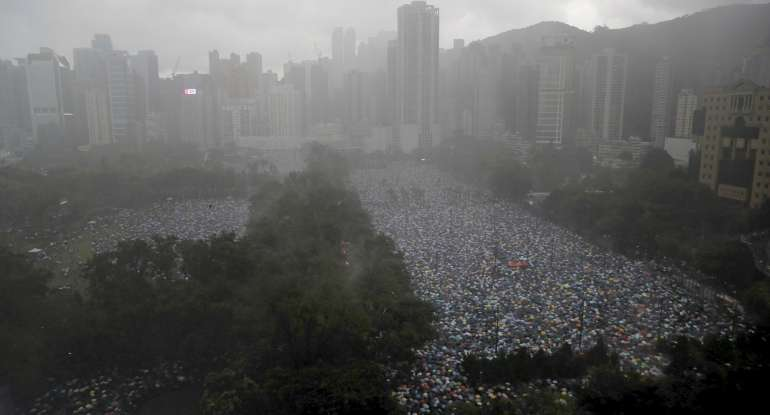 Protesters gather on Victoria Park in Hong Kong Sunday, Aug. 18, 2019.