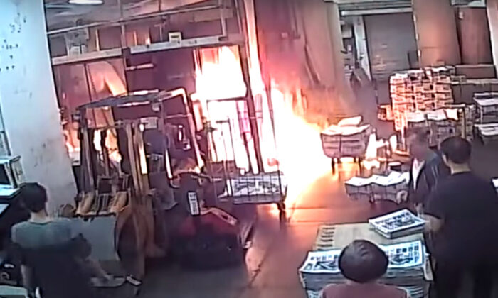 CCTV footage of the fire set by masked intruders at the printing press of The Epoch Times Hong Kong bureau on Nov. 19, 2019.