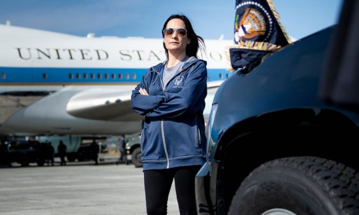 White House press secretary Stephanie Grisham waits as Air Force One is refueled at Elmendorf Air Force Base while traveling to Japan in Anchorage, Alaska, on June 26, 2019.
