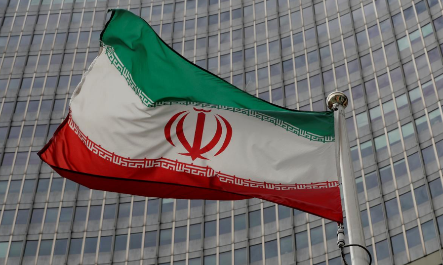 FILE PHOTO: An Iranian flag flutters in front of the International Atomic Energy Agency (IAEA) headquarters in Vienna, Austria September 9, 2019.