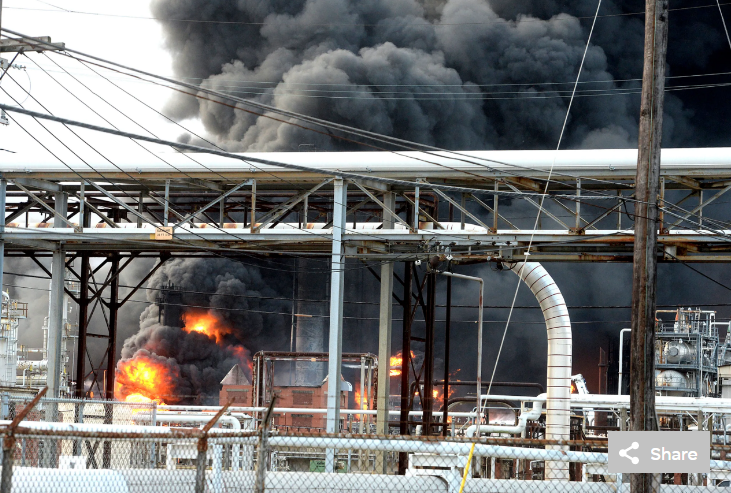Thick smoke fills the sky above the TPC Group Port Neches Operations as emergency response crews try to contain the fire that continued to burn throughout the morning following an overnight explosion on Wednesday, Nov. 27, 2019,
