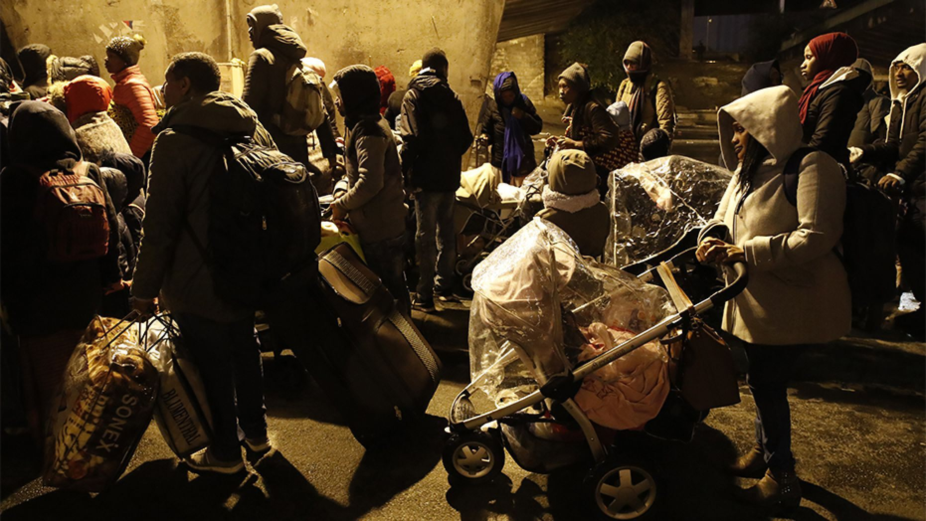 The migrants were bused away to several facilities in and around Paris Thursday after they were removed from the camps.