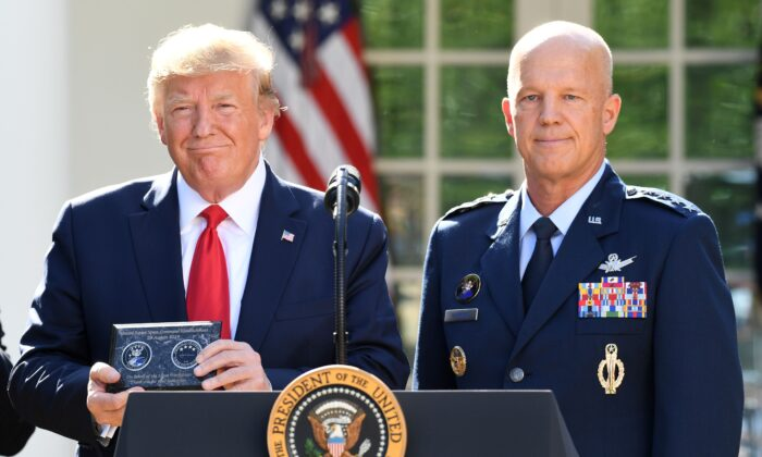General John W. Raymond (R) and President Donald Trump pose during an event establishing the US Space Command in the Rose Garden of the White House in Washington, on Aug. 29, 2019.