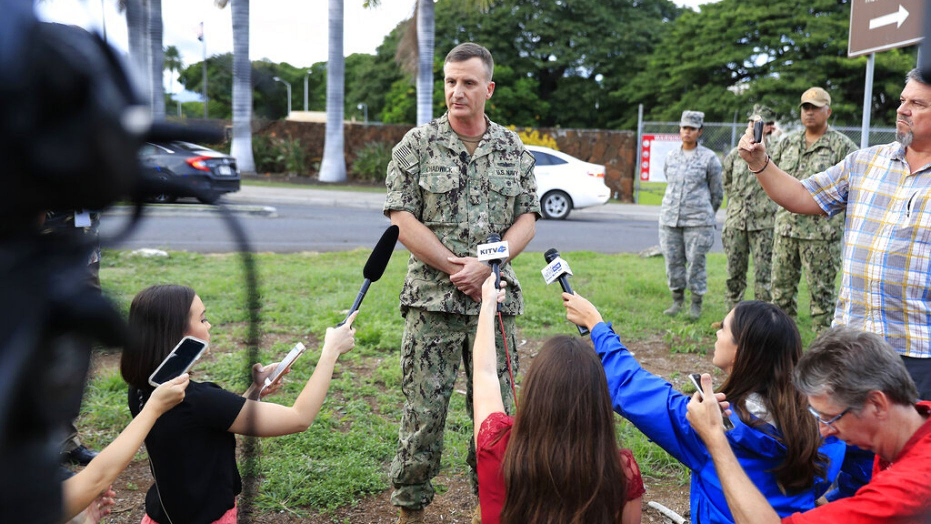 U.S. Navy Rear Adm. Robb Chadwick speaks to the media at the main gate at Joint Base Pearl Harbor-Hickam, Wednesday, Dec. 4, 2019, in Hawaii, following a shooting.
