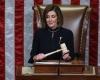 Pictured: Speaker Nancy Pelosi presides over the House of Representatives vote on the second article of impeachment of President Donald Trump, on December 18.